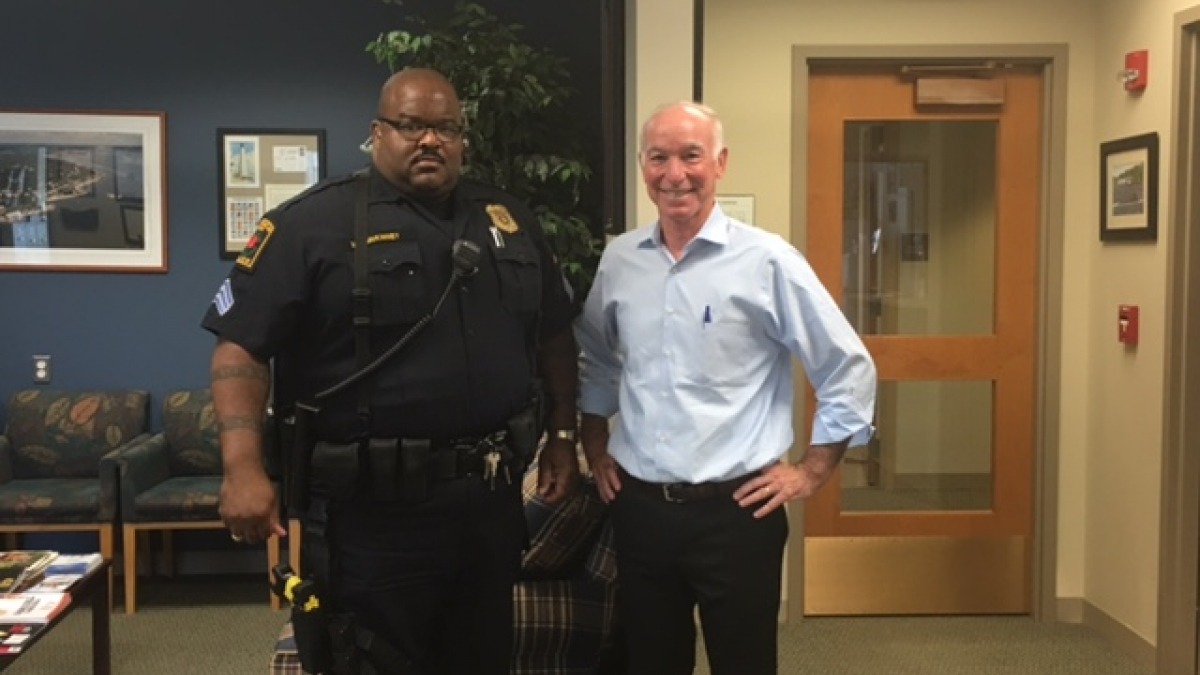 Courtney poses with Sergeant McKinney before joining him for a ride-along